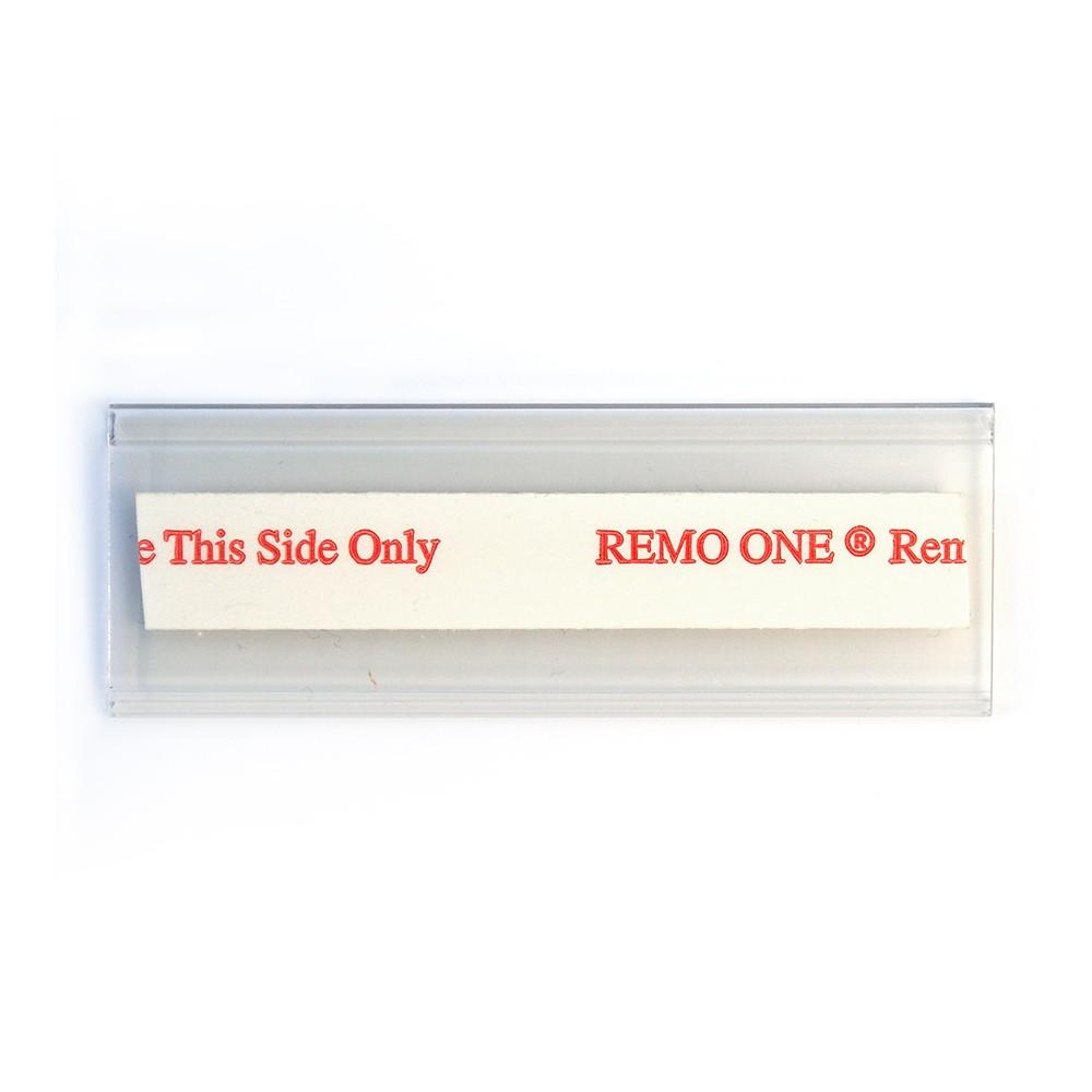 Etikettholderen har tape som kan brukes flere ganger