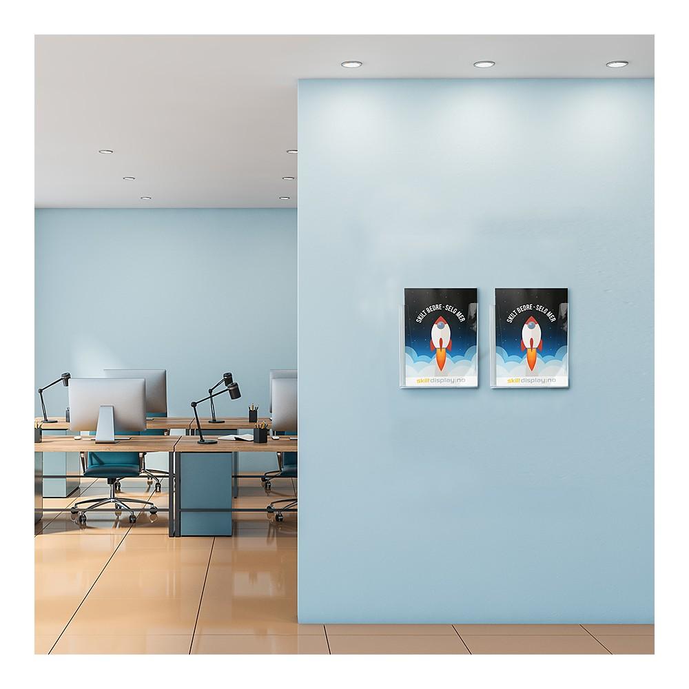 Brosjyreholder plexi til vegg i bruk, bruke gjerne flere brosjyreholdere ved siden av hverandre
